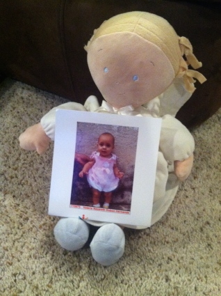 Evy Angel doll holding Valeria's picture