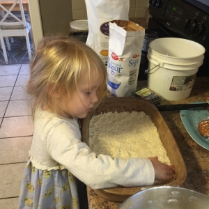 Ava making cookie bars